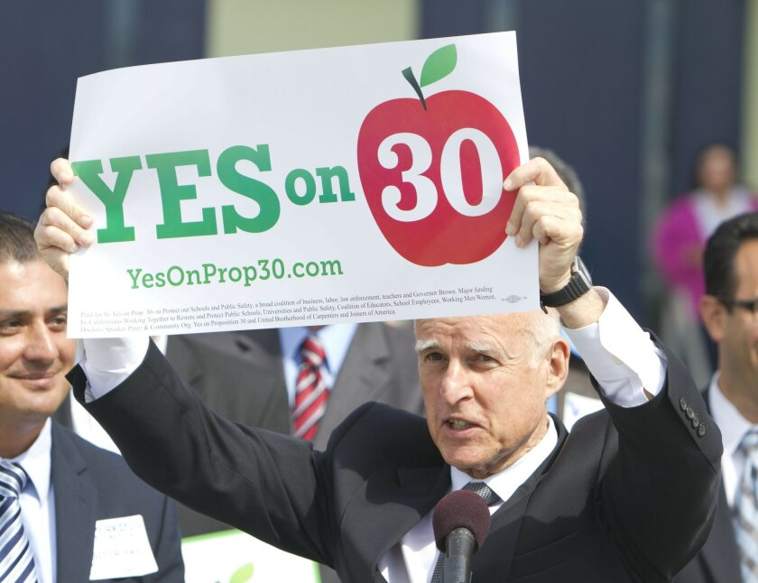 Gov. Jerry Brown, at a stop Tuesday in San Diego, urges a yes vote for his Proposition 30.