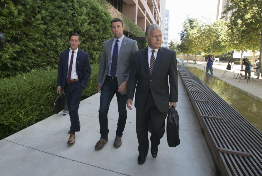 Rep. Duncan Hunter, center, walking to a trial-date change hearing