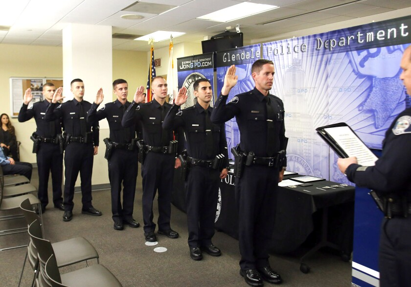Glendale Police Chief Carl Povilaitis administers the oath of office to six new officers who joined the department during a promotion and swearing in ceremony on Thursday, Sept. 12, 2019.