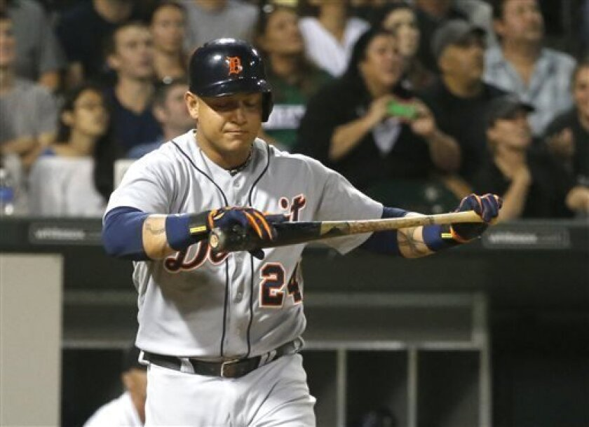 Detroit Tigers' Miguel Cabrera reacts after popping up off a pitch by Chicago White Sox starting pitcher Chris Sale during the eighth inning of a baseball game, Monday, Aug. 12, 2013, in Chicago. The White Sox won 6-2 with Sale pitching a complete game. (AP Photo/Charles Rex Arbogast)