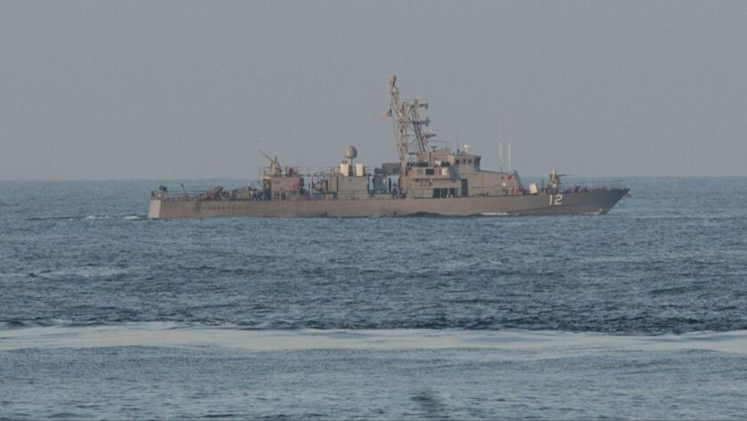 US patrol boat fires warning shots near Iranian naval ship