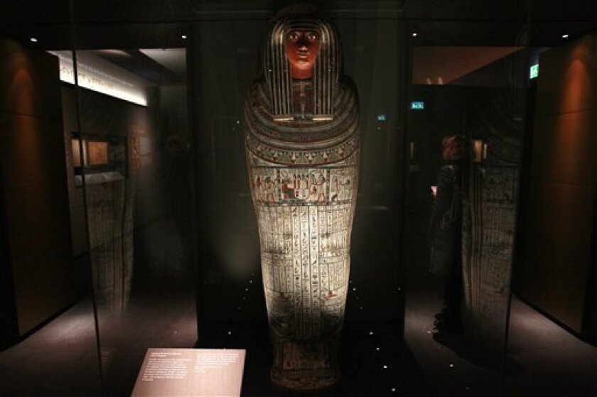 The coffin of Pasenhor, an influential member of the Libyan Meshwesh tribe, around the 22nd dynasty (725 BC) which is inscribed with various spells from the Book of the Dead, is seen at the British Museum in London, Tuesday, Nov. 2, 2010. The exhibition brings together treasures from the museum's collection of Egyptian artifacts, including fragile papyrus scrolls that are rarely shown in public. (AP Photo/Alastair Grant)