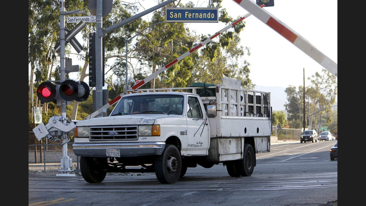 """While officers waited near this location during """"Operation Clear Track,"""" a truck sped up to get past the railroad crossing arms before they dropped as a Metrolink train approached during its morning commute at Doran Street and San Fernando Rd. in Glendale/Los Angeles on Tuesday, Sept. 26, 2017. A press conference for Rail Safety Month was being held nearby. The driver, who did not want to give his name, was given a ticket by an L.A. County Sheriff deputy who was stationed nearby."""