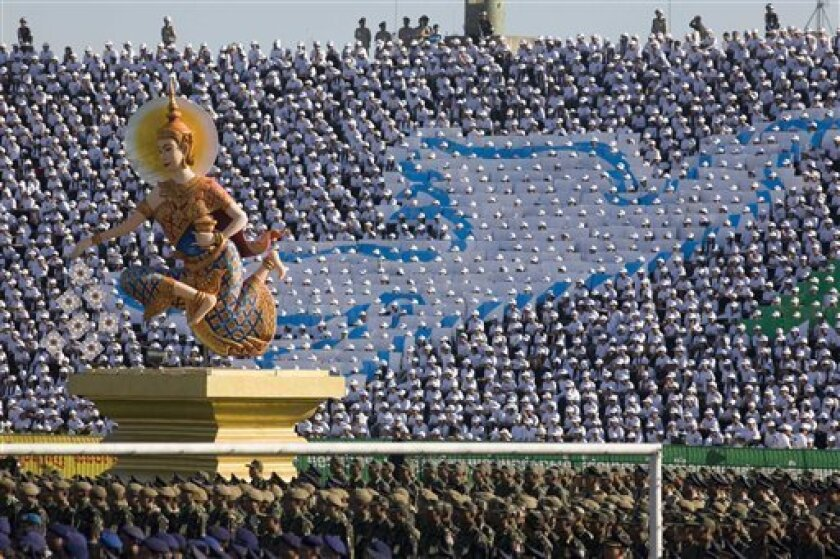 """A statue of a Cambodian """"Apsara"""" takes center stage during ceremonies at Olympic Stadium Wednesday, Jan. 7, 2009, in Phnom Penh, Cambodia, celebrating the fall of the Khmer Rouge regime 30 years ago.  As scheduled, the first trial of the Khmer Rouge leaders will take place sometime in the first qua"""
