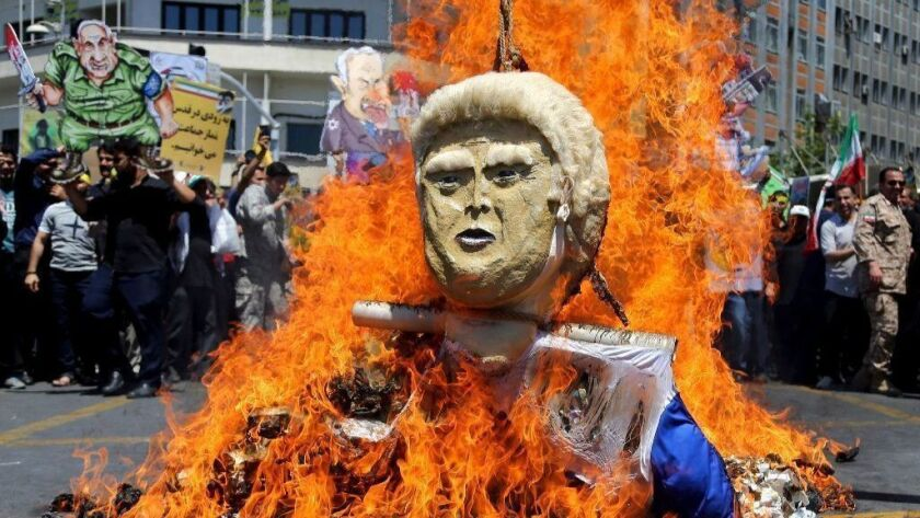 An effigy of President Trump is set on fire during annual anti-Israel protests organized by the Iranian government on June 8, 2018, in Tehran.