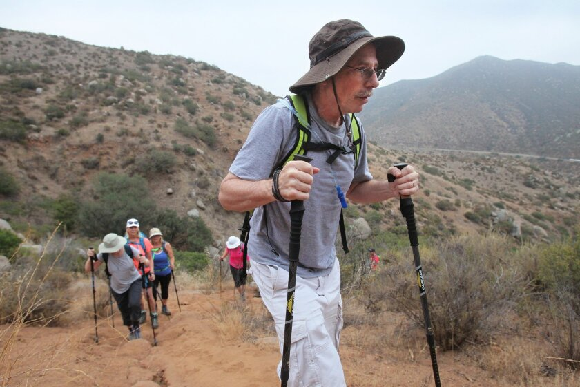 Mike Abrams, who has Parkinson's disease, hikes the strenuous Clevenger Canyon Trail near Ramona with the non-profit group Summit for Stem Cell.