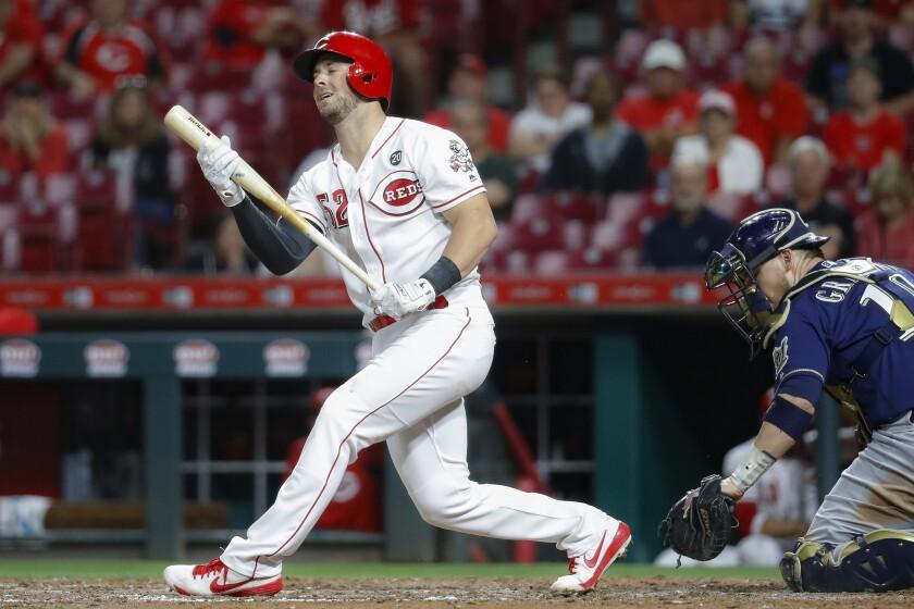Cincinnati Reds' Kyle Farmer strikes out to Milwaukee Brewers relief pitcher Josh Hader, ending a baseball game Tuesday, Sept. 24, 2019, in Cincinnati. (AP Photo/John Minchillo)