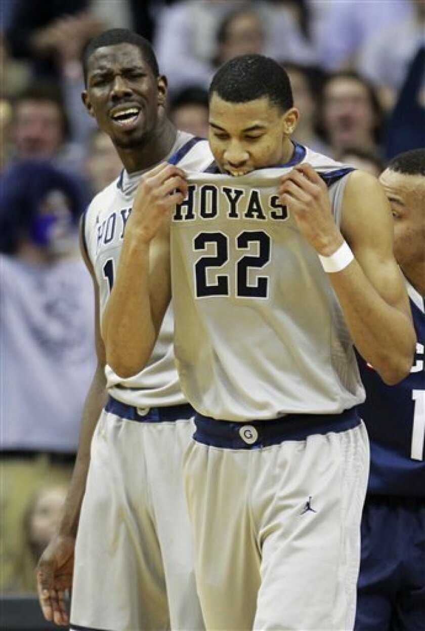 Georgetown's Otto Porter (22) and Henry Sims, rear, react to a play during the first half of an NCAA college basketball game against Connecticut, Wednesday, Feb. 1, 2012, in Washington. (AP Photo/Haraz Ghanbari)