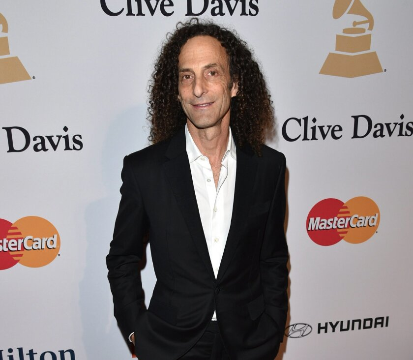 FILE-- In this Saturday, Feb. 7, 2015 file photo, Kenny G arrives at the 2015 Clive Davis Pre-Grammy Gala at the Beverly Hilton Hotel in Beverly Hills, Calif. The 58-year-old artist, born Kenneth Gorelick, hungers for a certain cachet beyond platinum plaques. He'd like tunes from his latest album,