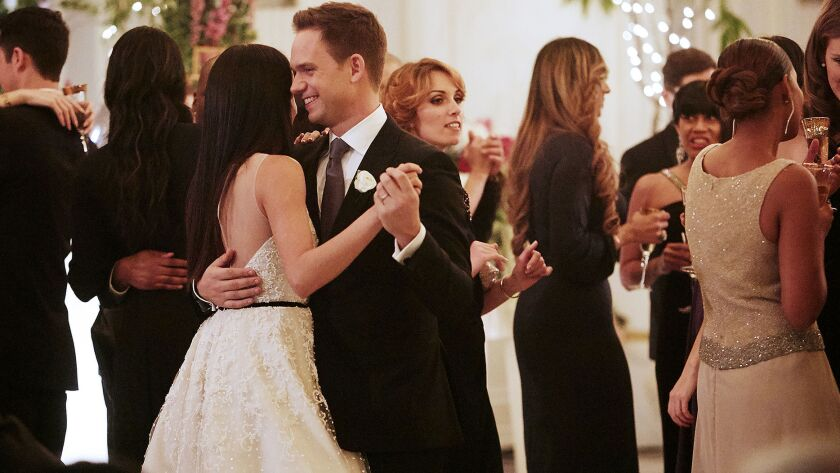 "Meghan Markle and Patrick Adams after their wedding on the season finale of ""Suits."""