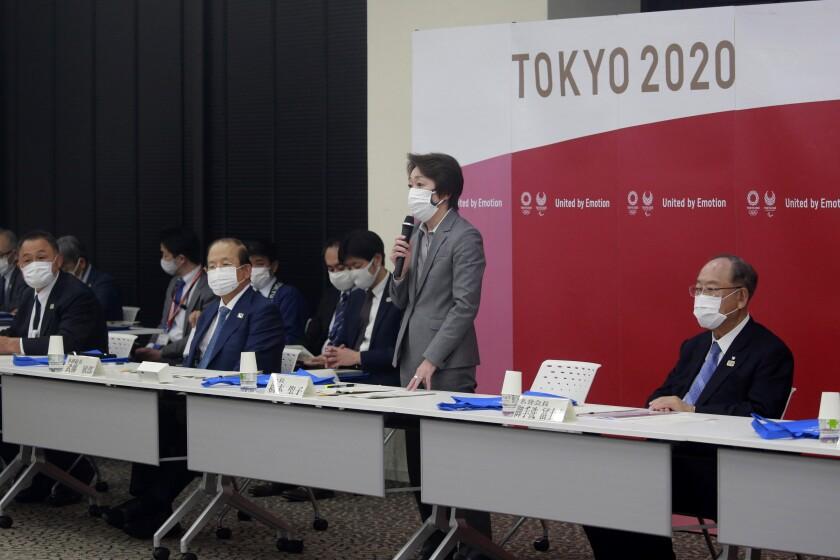 Tokyo 2020 Organizing Committee President Seiko Hashimoto, center, speaks during a Tokyo 2020 executive board meeting in Tokyo, Tuesday, March 2, 2021. (AP Photo/Koji Sasahara, Pool)