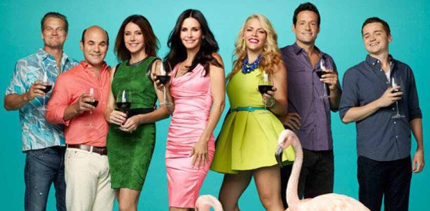 """Courteney Cox (center) and the cast of """"Cougar Town."""""""