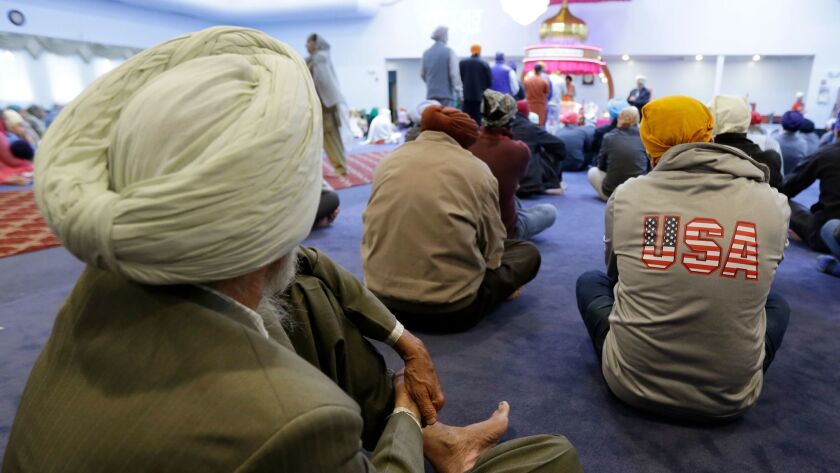 Men attend Sunday services at a Sikh temple in Renton, Wash.