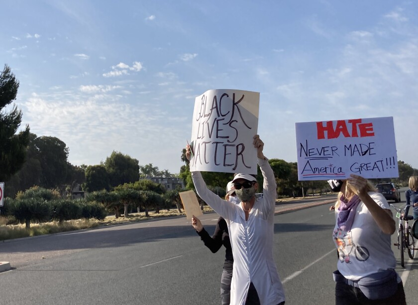 Protesters in Solana Beach marched down the 101 Wednesday morning.