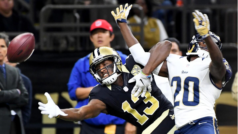 Saints receiver Michael Thomas and Rams cornerback Lamarcus Joyner get tangeled on a pass play during the third quarter.