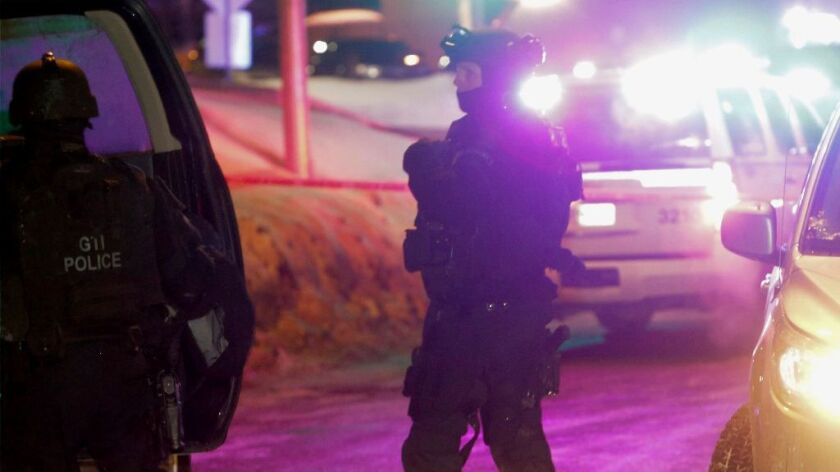 Police survey the scene after a deadly shooting at a mosque in Quebec City, Canada, Sunday, Jan. 29, 2017.