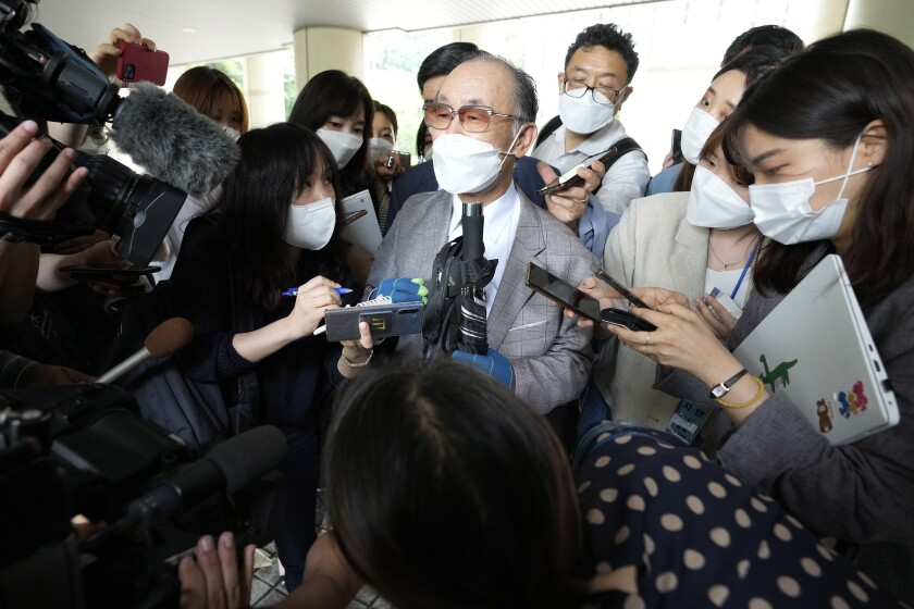 Lim Chul-ho, center, the son of a deceased forced laborer, speaks at the Seoul Central District Court in Seoul, South Korea, Monday, June 7, 2021. A South Korean court on Monday rejected a claim by dozens of wartime Korean factory workers and their relatives who sought compensation from 16 Japanese companies for their slave labor during Japan's colonial occupation of Korea. (AP Photo/Ahn Young-joon)