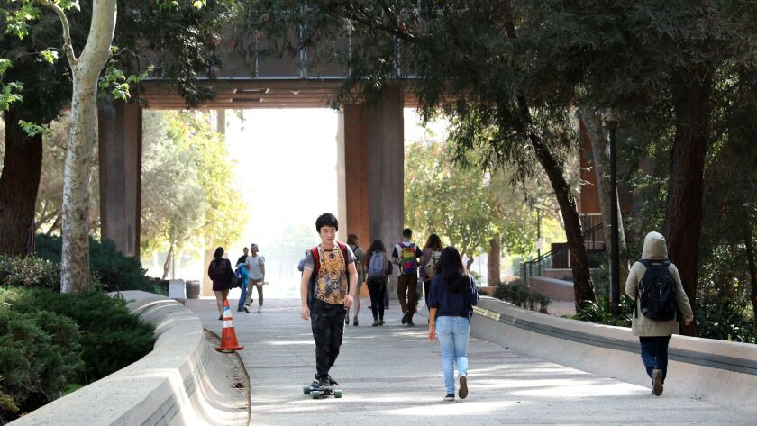 Students walk to and from classes at UCLA on March 1, 2016.