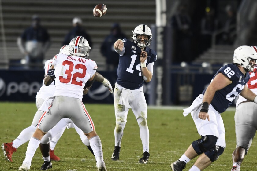 Penn State quarterback Sean Clifford (14) throws a pass against Ohio State during the third quarter of an NCAA college football game in State College, Pa., Saturday, Oct. 31, 2020. Ohio State won 38-25. (AP Photo/Barry Reeger)