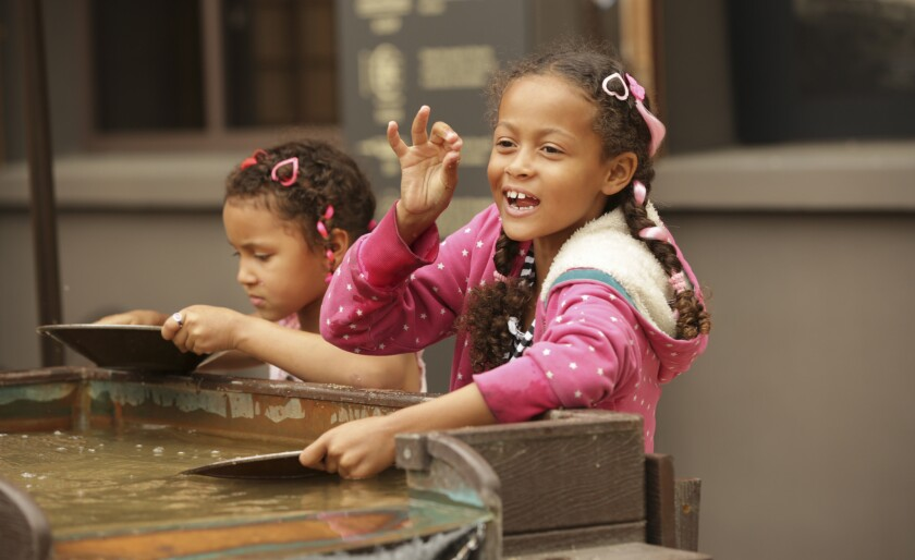 Kids panning for gold at the Autry Museum of the American West in Griffith Park, Los Angeles, CA.