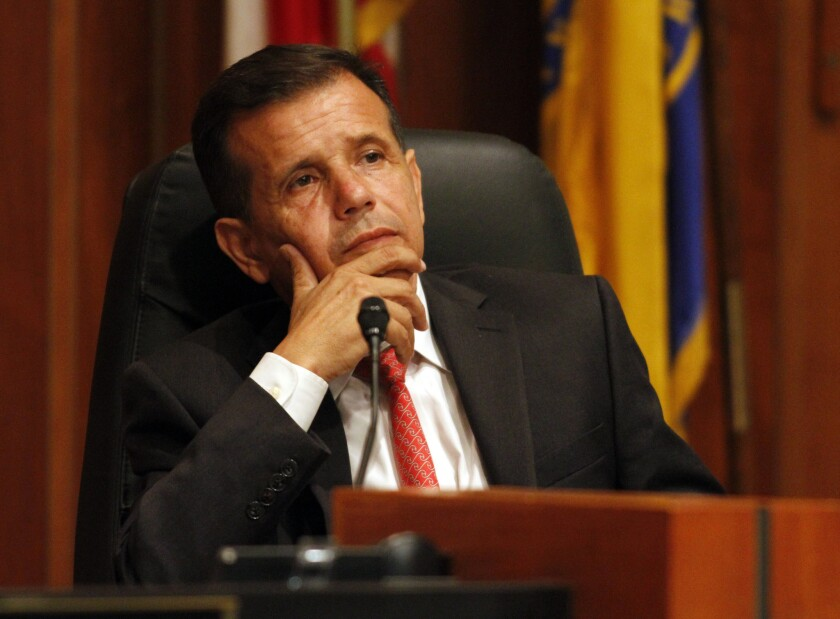 Santa Ana Mayor Miguel Pulido has settled accusations that he violated the state's conflict-of-interest and financial reporting laws.