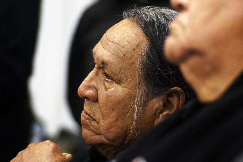 FILE - In this Dec. 5, 2016, file photo, Chief Leonard Crow Dog listens during an orientation at Sitting Bull College in Cannon Ball, North Dakota. Crow Dog, 78, died Sunday, June 6, 2021, at his home at Crow Dog's Paradise on the Rosebud Indian Reservation in South Dakota. The renowned Lakota spiritual leader and activist fought for tribal sovereignty, language preservation, religious freedom and traditional ways of life.(Richard Tsong-Taatarii/Star Tribune via AP, File)
