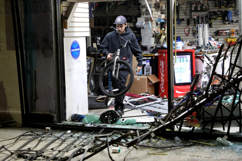 Looters and vandals ransack Spokes 'N Stuff at Melrose Avenue and Ogden Drive on Saturday.