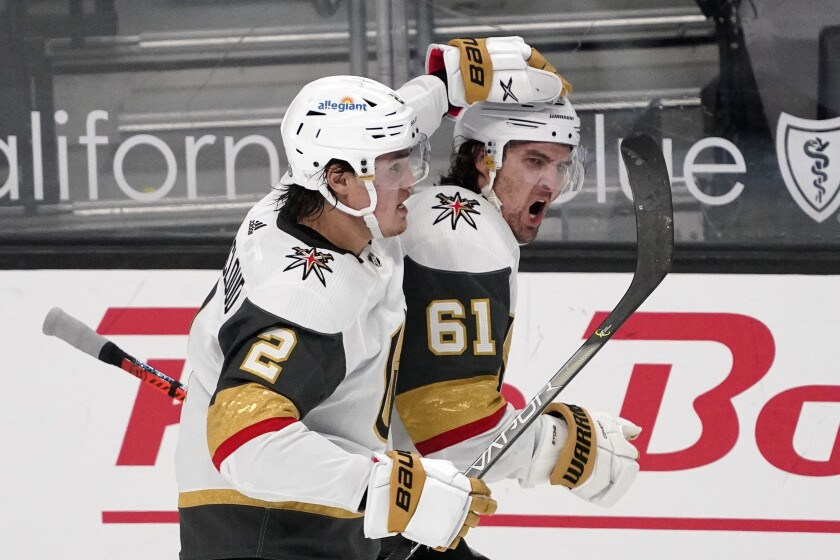 Vegas Golden Knights right wing Mark Stone, right, celebrates his goal with defenseman Zach Whitecloud during the second period of an NHL hockey game against the Los Angeles Kings Monday, April 12, 2021, in Los Angeles. (AP Photo/Mark J. Terrill)