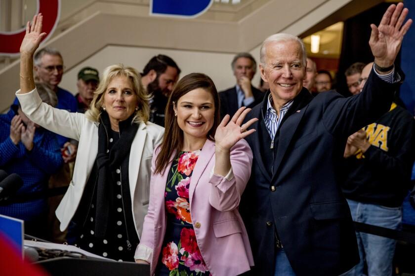 Joe Biden and his wife, Jill, flank Rep. Abby Finkenauer at a campaign event in Iowa.