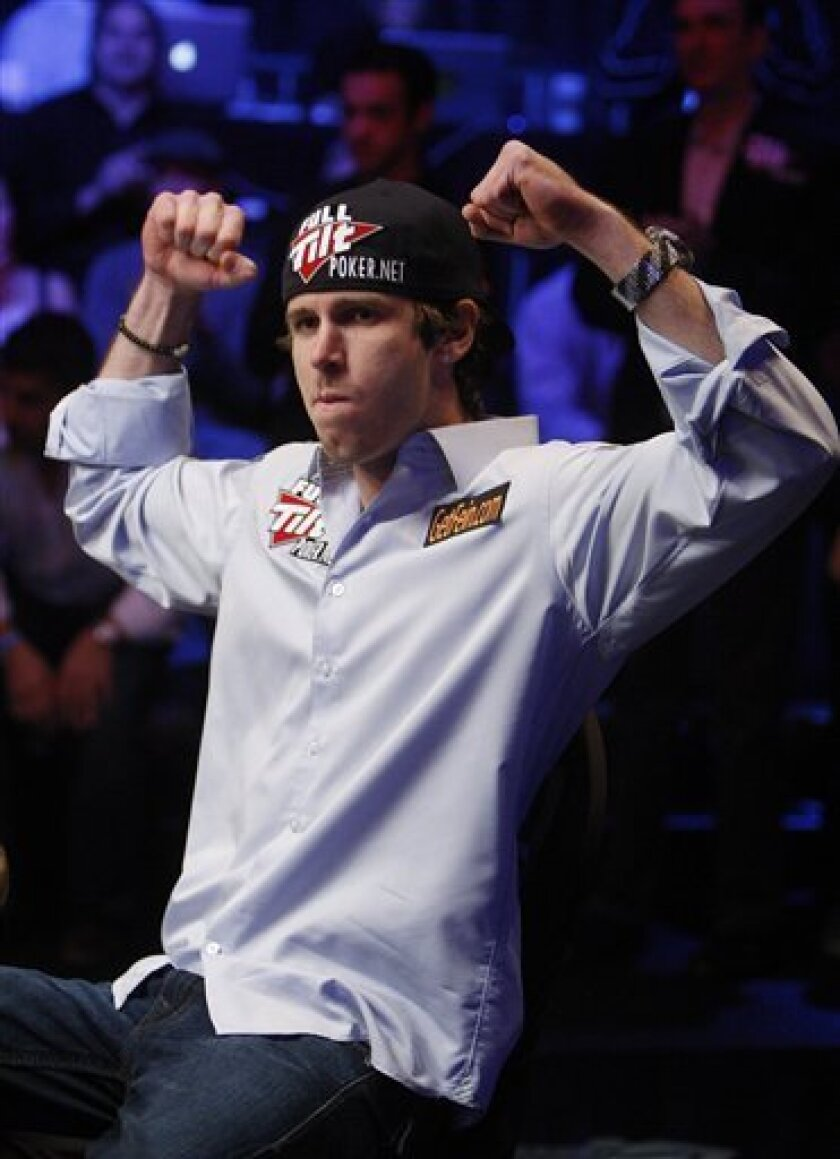 John Racener raises his arms to the crowd before competing against Johnathan Duhamel at the final table of the World Series of Poker, Monday, Nov. 8, 2010, in Las Vegas. (AP Photo/Isaac Brekken)