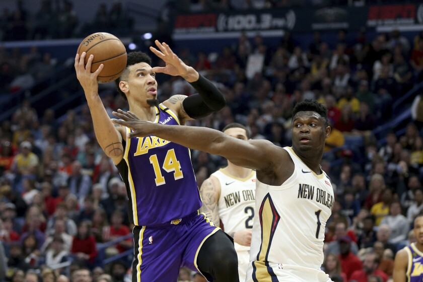 The Lakers' Danny Green drives against the Pelicans' Zion Williamson on March 1, 2020.