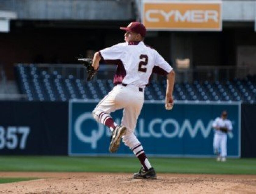 Robby Schreiber rocks in windup in the Knights' game at Petco Park against Santa Fe Christian April 4. The Bishop's School varsity head coach Joey Centanni is offering baseball camps this summer on campus.  Ed Piper