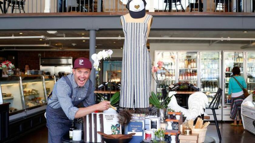 Brian Malarkey is one of several San Diego chefs/restaurant owners who curate retail goods to sell at their eateries. Malarkey's Herb + Eatery features an eclectic mix of found objects and custom-created ones, like the Huntington Co. chefs' aprons. (K.C. Alfred / Union-Tribune)