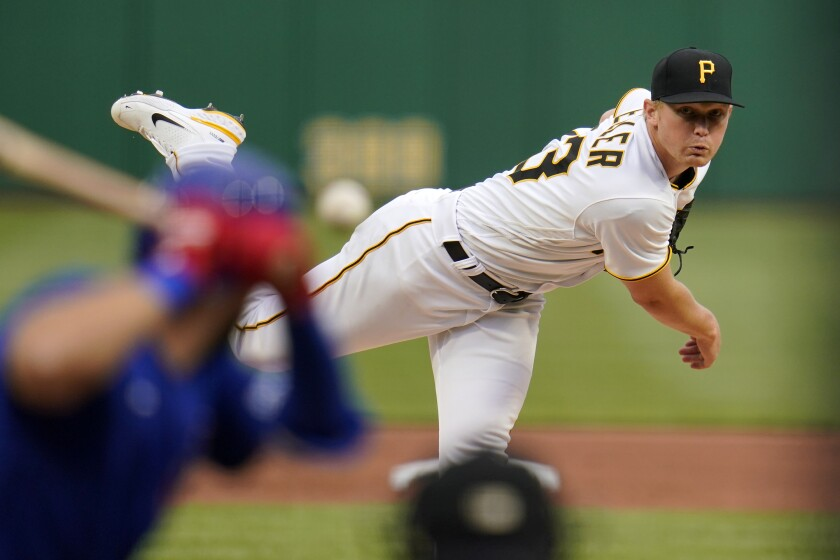 Pittsburgh Pirates starting pitcher Mitch Keller delivers during the second inning of the team's baseball game against the Chicago Cubs in Pittsburgh, Saturday, April 10, 2021. (AP Photo/Gene J. Puskar)
