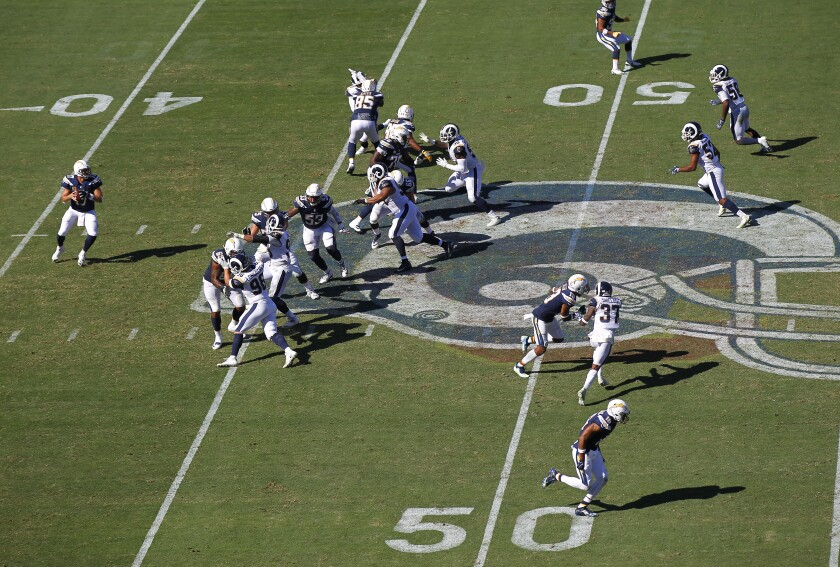 "The Chargers run a play against the Rams in L.A. on Sept. 23, 2018. The teams will be featured on ""Hard Knocks"" in August."
