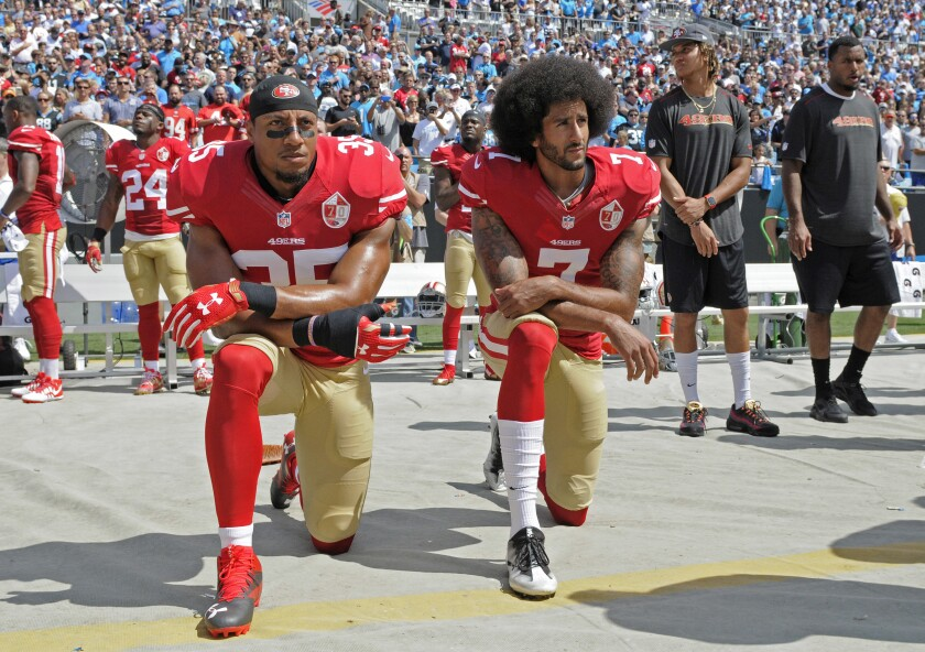San Francisco 49ers' Eric Reid, left, and Colin Kaepernick kneel during the national anthem in September 2016.