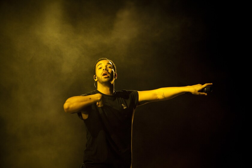 Drake performs during his headlining set at the Coachella Valley Music and Arts Festival in Indio.