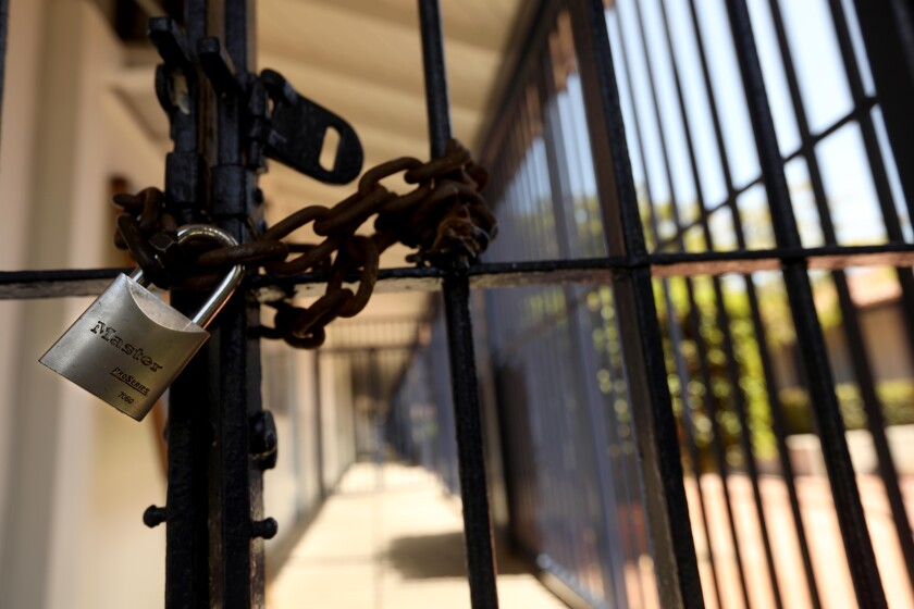 A padlock keeps the campus of Short Avenue Elementary School shuttered on Monday in Mar Vista.