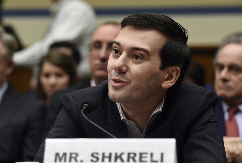 """Martin Shkreli, the former head of Turing Pharmaceuticals, speaks on Capitol Hill on Thursday. He pleaded the 5th Amendment at a congressional committee hearing on drug-price hikes, but tweeted that lawmakers were """"imbeciles."""""""