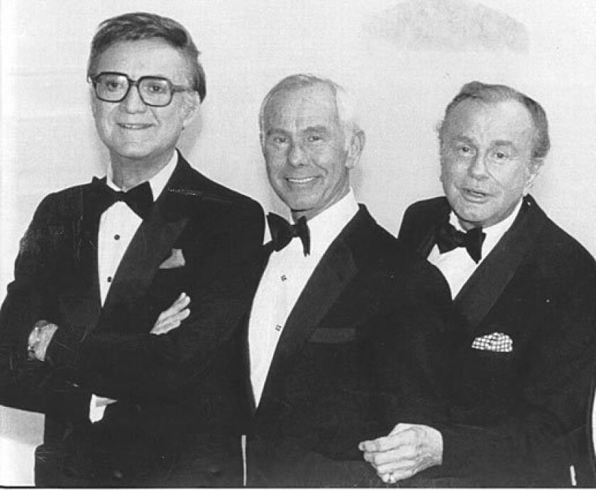 """It's rare that """"Tonight Show"""" hosts get together like in this 1986 photo from """"NBC's 60th Anniversary Celebration"""" that brought (from left) Steve Allen, Johnny Carson and Jack Paar in one room. Allen introduced the format that everyone now knows and follows (the couch, the celebrity guest, comedy bits), Paar helped brand and popularize the show, and Carson (to some) perfected it. Here are a few moments throughout the show's history that stand out."""