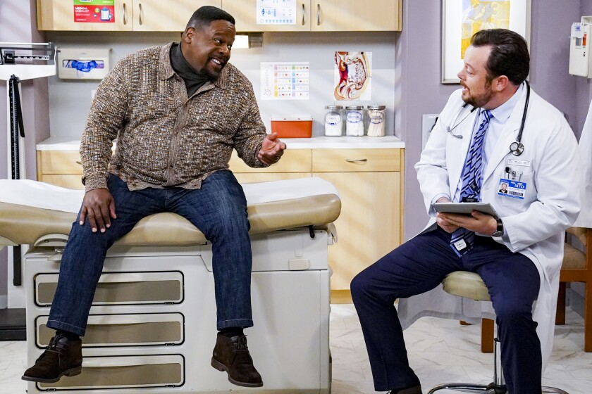 "Cedric the Entertainer, left, and Michael Gladis in ""The Neighborbood"" on CBS."