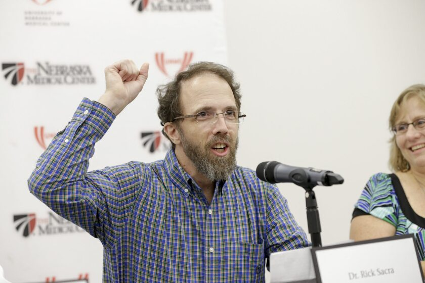 Former Ebola patient Dr. Richard Sacra at a news conference at the Nebraska Medical Center in Omaha, Neb. As part of his treatment, he received a transfusion of convalescent plasma.