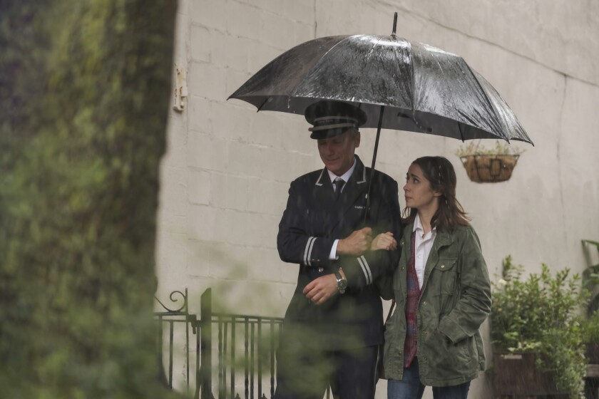 """Laurentiu Possa is a protective doorman and Cristin Milioti a young tenant in his building in Amazon's """"Modern Love."""""""