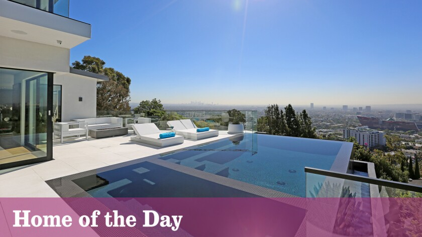 Unobstructed 270-degree views set the stage for this contemporary-style home on the market for $12.995 million.