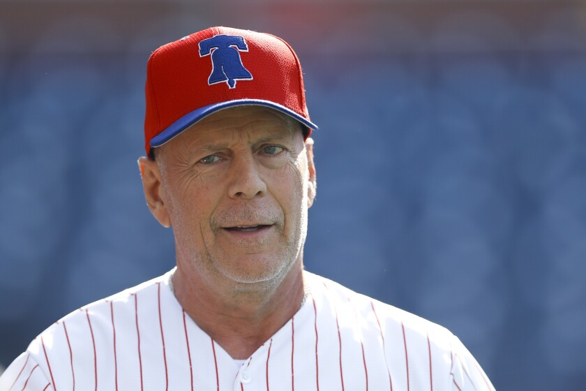 Bruce Willis in a Philadelphia Phillies baseball uniform