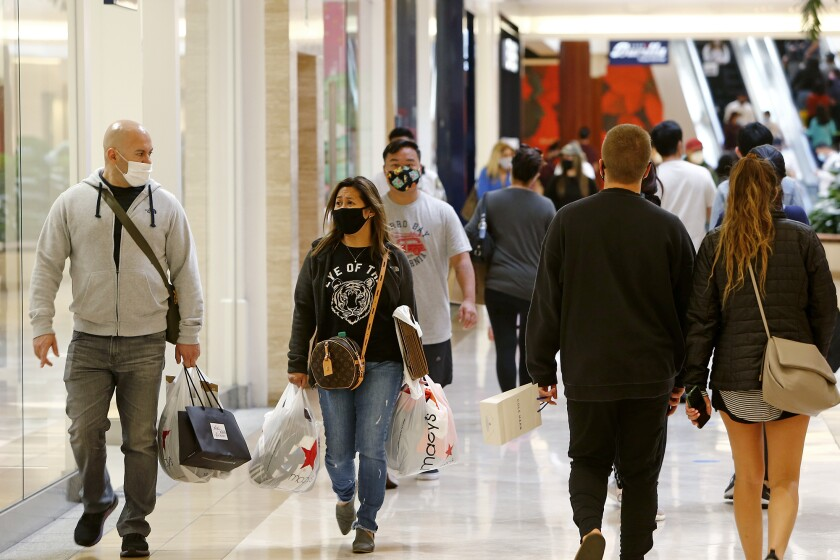 Holiday shoppers at South Coast Plaza in Costa Mesa on Saturday.