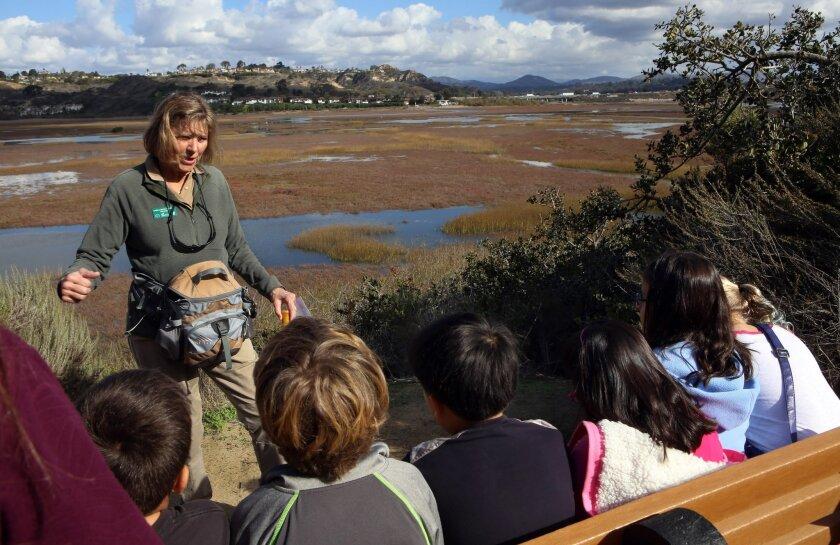 San Elijo Conservancy docent Karen Larsen-Gordon talks with fourth-graders from Skyline Elementary School during an educational hike at San Elijo Lagoon. / photo by Bill Wechter * U-T San Diego
