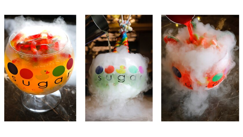 The bubbling, $39 60-ounce cocktail goblets at Sugar Factory are fueled by dry ice and ready for their social media close-ups. From left are the White Gummi, the Lollipop Passion and the Watermelon Patch. Smaller versions are available at the movie theater.