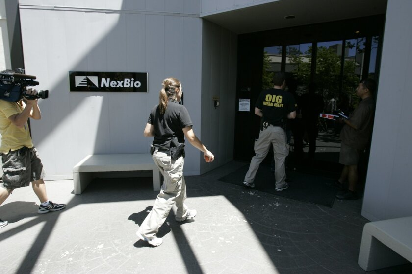 Federal agents entered the headquarters of NexBio Thursday as part of an effort to serve search warrants on the San Diego biotechnology company.