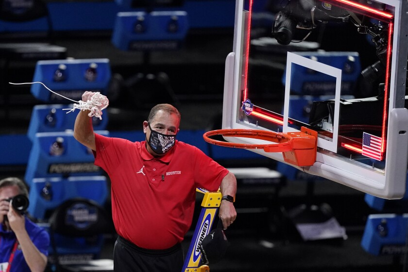Houston head coach Kelvin Sampson cuts a net down after beating Oregon State 67-61 during an Elite 8 game in the NCAA men's college basketball tournament at Lucas Oil Stadium, Monday, March 29, 2021, in Indianapolis. (AP Photo/Darron Cummings)